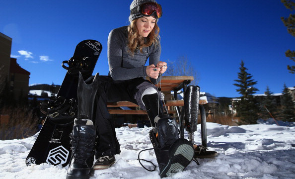 COPPER MOUNTAIN, CO - DECEMBER 16:  Amy Purdy swaps her prosthetic legs as she prepares for a training session on December 16, 2013 in Copper Mountain, Colorado. Purdy is a a member of the US Paralymic Snowboard Team and co-founder of Adaptive Action Sports.  (Photo by Doug Pensinger/Getty Images)